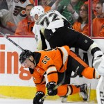 Center Nick Cousins (#52) of the Philadelphia Flyers throws a check against Right Wing Patric Hornqvist (#72) of the Pittsburgh Penguins during the second period