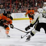 Defenseman Brian Dumoulin (#8) of the Pittsburgh Penguins defends against a stopping Defenseman Mark Streit (#32) of the Philadelphia Flyers during the third period