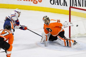 Left Wing Taylor Hall (#4) of the Edmonton Oilers scores a goal against Goalie Michal Neuvirth (#30) of the Philadelphia Flyers during the second period