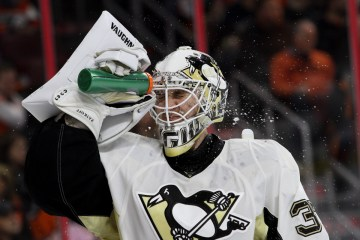 Goalie Jeff Zatkoff (#37) of the Pittsburgh Penguins sprays water on his face during the second period