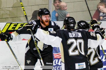 James Melindy (WHL - 6) celebrates his goal with Jarrett Burton (WHL - 20) and Riley Brace (WHL - 23).