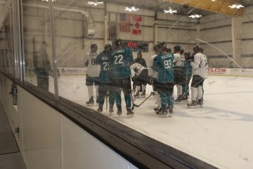 Prospects huddling at Sharks Ice. July 8, 2016.