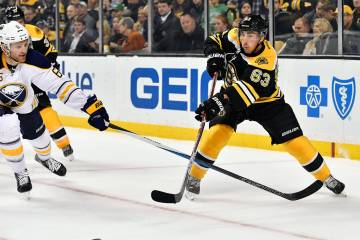Nov 7th, 2016; Boston Bruins left wing Brad Marchand (63) passes the puck in front of Buffalo Sabres defenseman Cody Franson (6) during a NHL game against the Buffalo Sabres. Credit: Brian Fluharty-Inside Hockey.