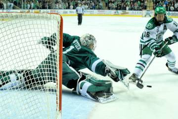 UND forward Brock Boeser puts a put on BSU goalie Michael Bitzer(Courtesy: Russell Hons for UNDsports.com)