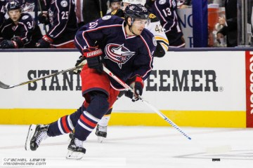 Brandon Saad (CBJ - 20) skates the puck through the neutral zone.