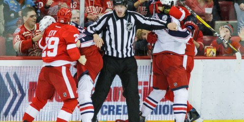 NHL linesman John Grandt (98) has his hands full with Steve Ott (DET - 29) tussling with Scott Hartnell (CBJ - 43) and Josh Anderson (CBJ - 34) tussling with Tomas Jurco (DET - 26).