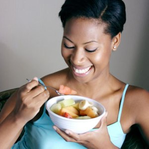 woman-eating-fruit-salad-fb[fusion_builder_container hundred_percent=