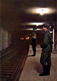 Guards at a ghost station underneath the Berlin wall.