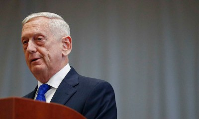 Former US defense secretary testifies in Holmes fraud trial