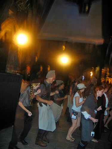 Three Broomsticks staff and attendees do the