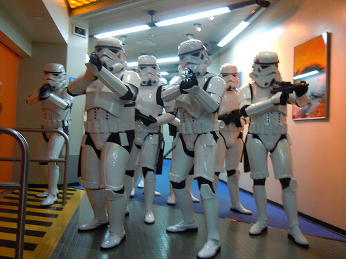 Stormtroopers menacingly urge guests out of Star Tours