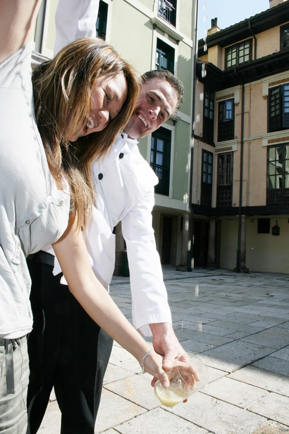 Practising pouring cider in Asturias