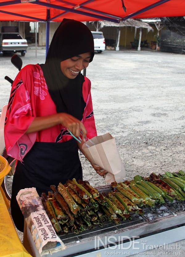 Malaysia woman serving banana wraps