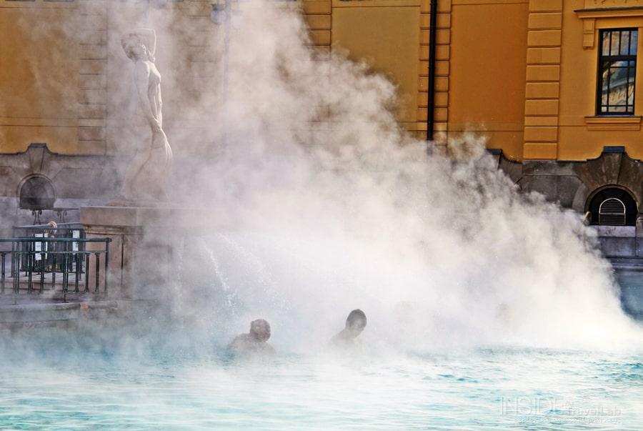 Baths in Budapest two men beneath steam