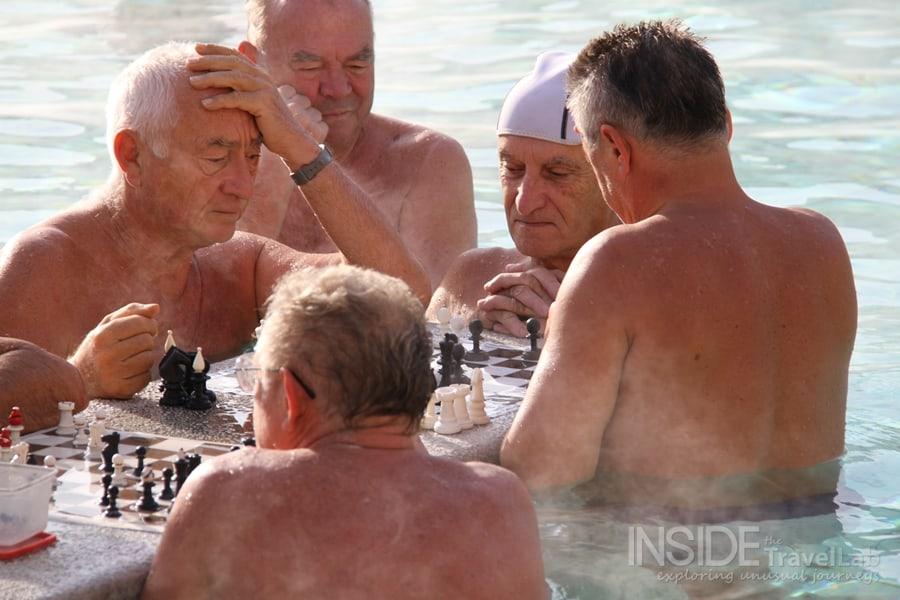 Medium shot playing chess in budapest baths