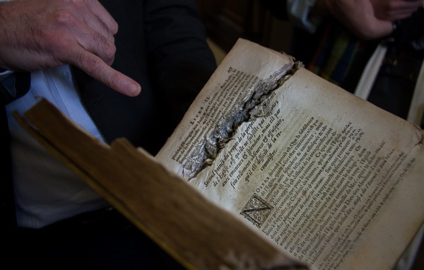 Gunshot wounds in book in Marsh's Library from @insidetravellab