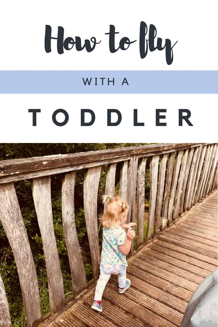 Travel with toddler airplane guide. How to fly with a toddler. Hands on tips to help you tackle a long haul flight with a toddler with ease. Includes travel toys for toddlers, snack ideas for toddlers and sanity savers for you, here's how to have an easy and enjoyable flight. Honest! #travel #toddler #TravelTips