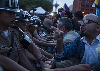 Anti-Corruption protesters in Guatemala City confront police
