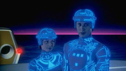 Two people wearing outfits covered with blue lights from Tron