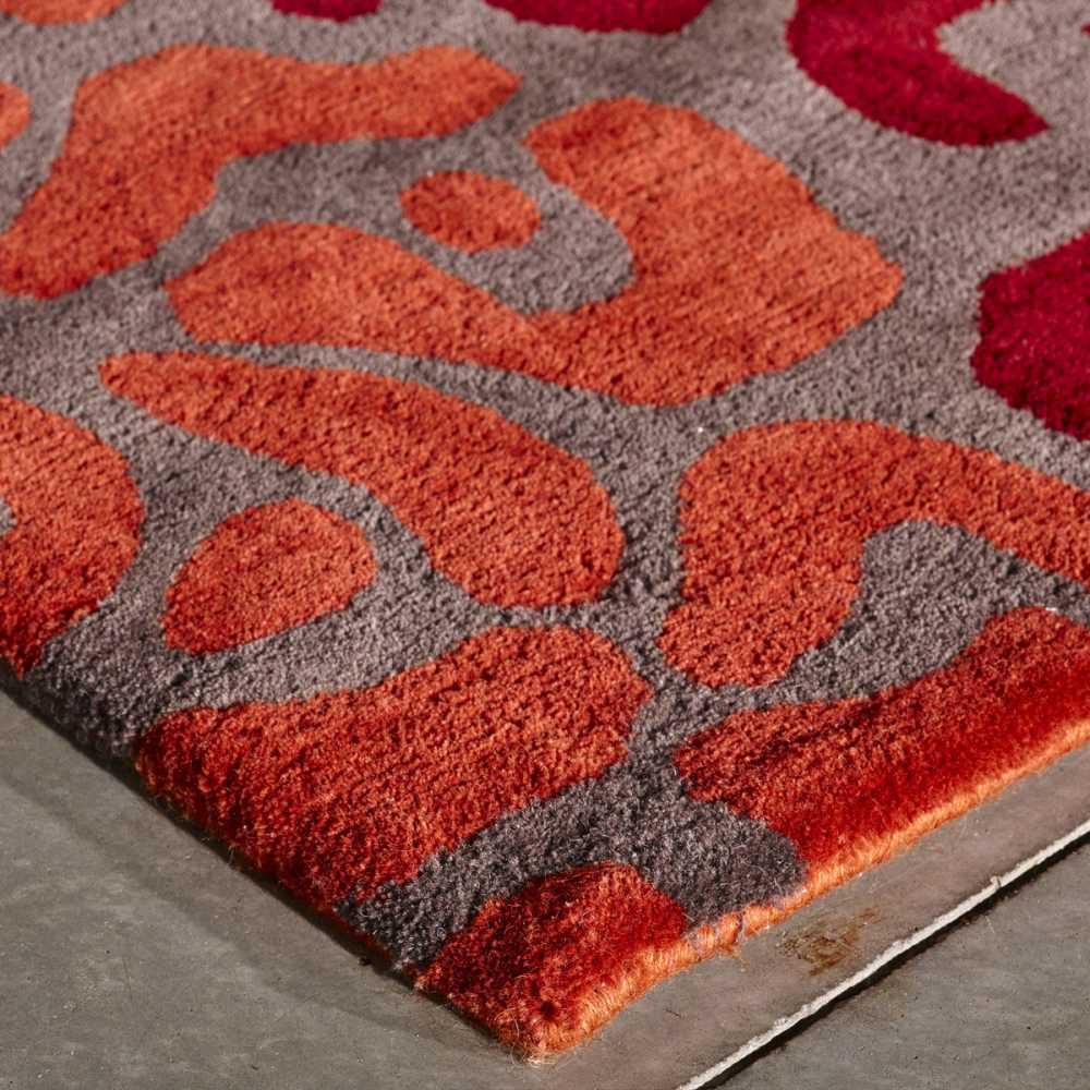 tapis de salon multicolore effet leopard en laine et viscose par angelo
