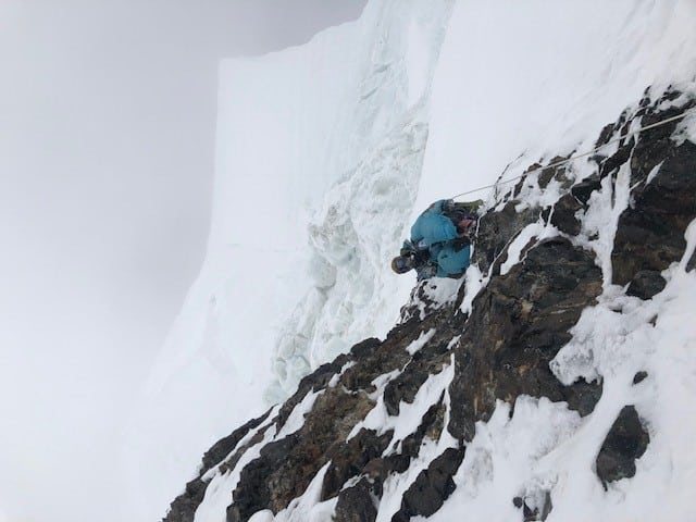 Gelgi Sherpa coming down the bottleneck underneath the looming ice serac
