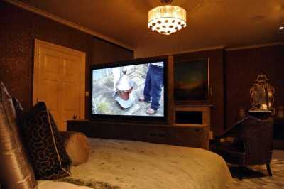 Guest bedroom motorised Bed TV