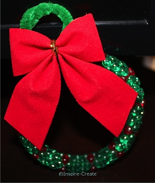 Wreath Ornament made with Tri Beads and a red velvet bow