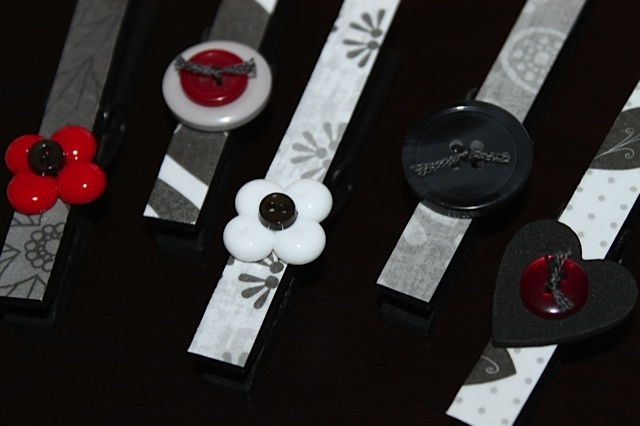 heart and flower embellishments attached to clothespins