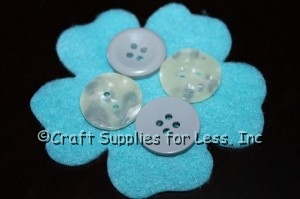 flat craft buttons attached to felt flower