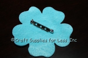 """attach 1 1/4"""" silver pin back to felt flower"""