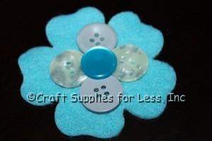 attach center button to felt flower