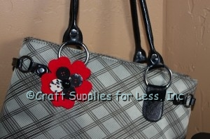 red felt flower with buttons attached to bag