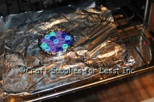 Pony Beads in Bottle Cap on foil in oven