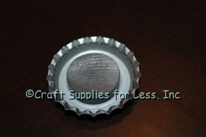 ceramic magnet attached to inside of bottle cap