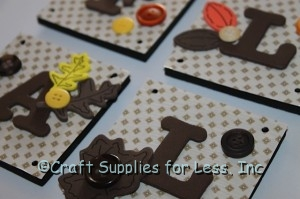 add buttons and fall stickers to foam squares