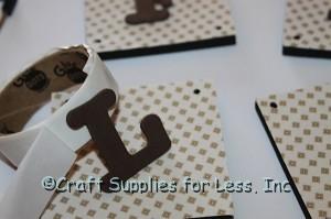 foam letter shape added with mini glue dot