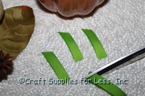 "cut green grosgrain ribbon into 1 1/2"" pieces"