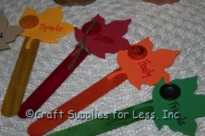 thankful craft sticks with words on leaves