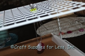 wire rack and binder clip holding polish gems