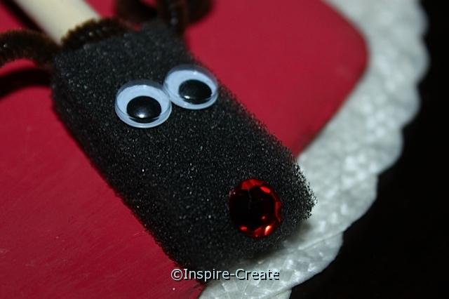 Reindeer Ornament add wiggle eyes and jewel to foam brush