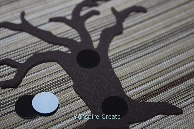 attach adhesive craft magnet to tree trunk