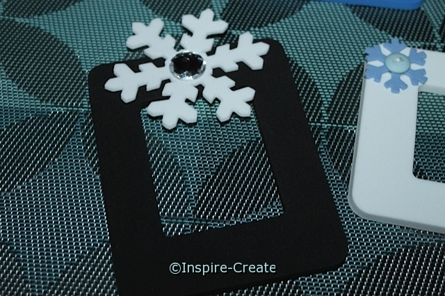 Try adding a Large Snowflake Shape to the top of a Craft foam frame!