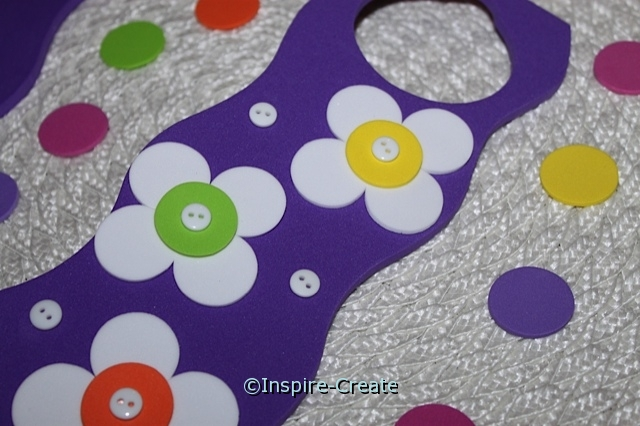 add buttons to foam flower door hanger