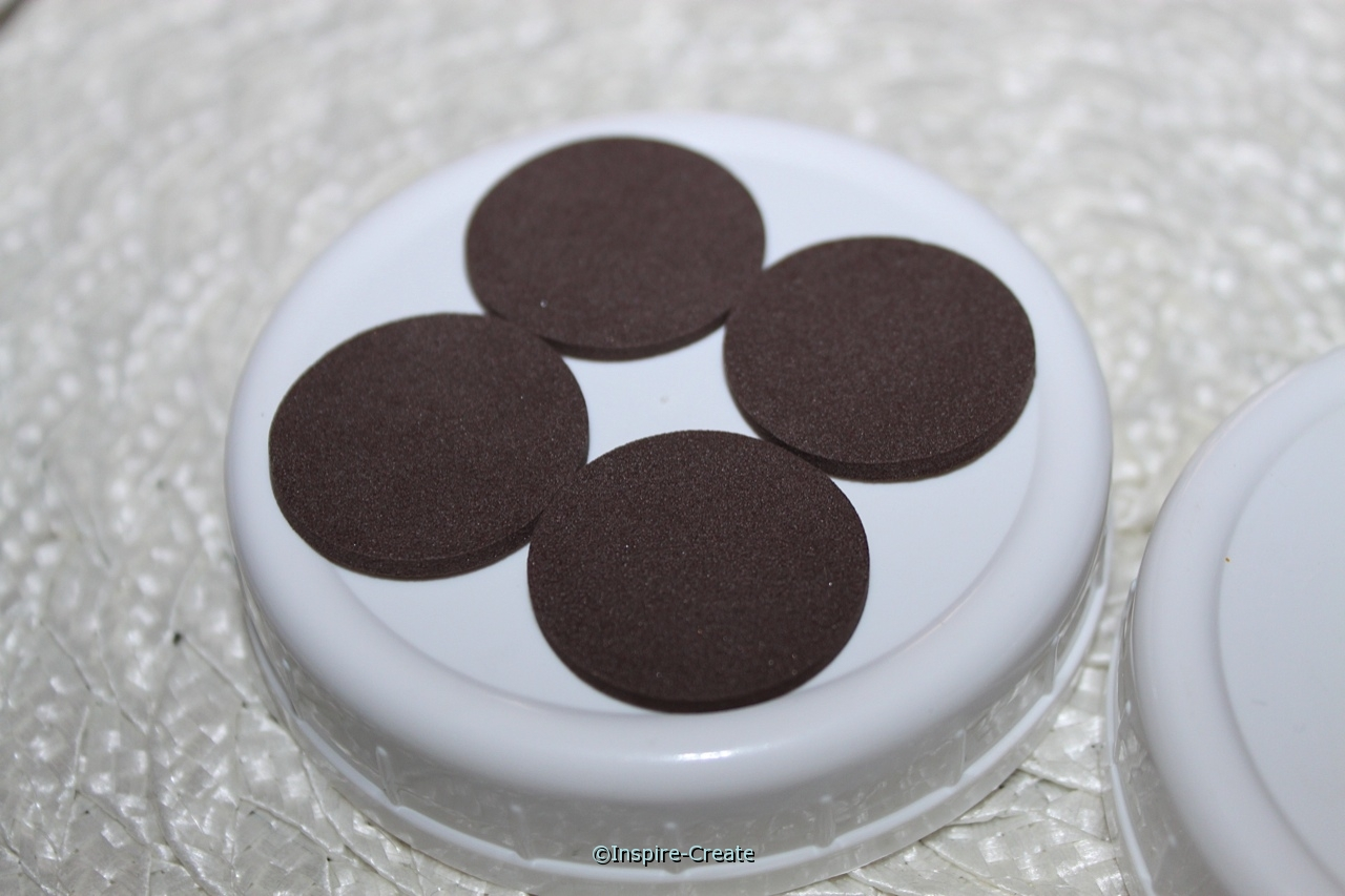 add brown circles to mason jar lid with glue dots
