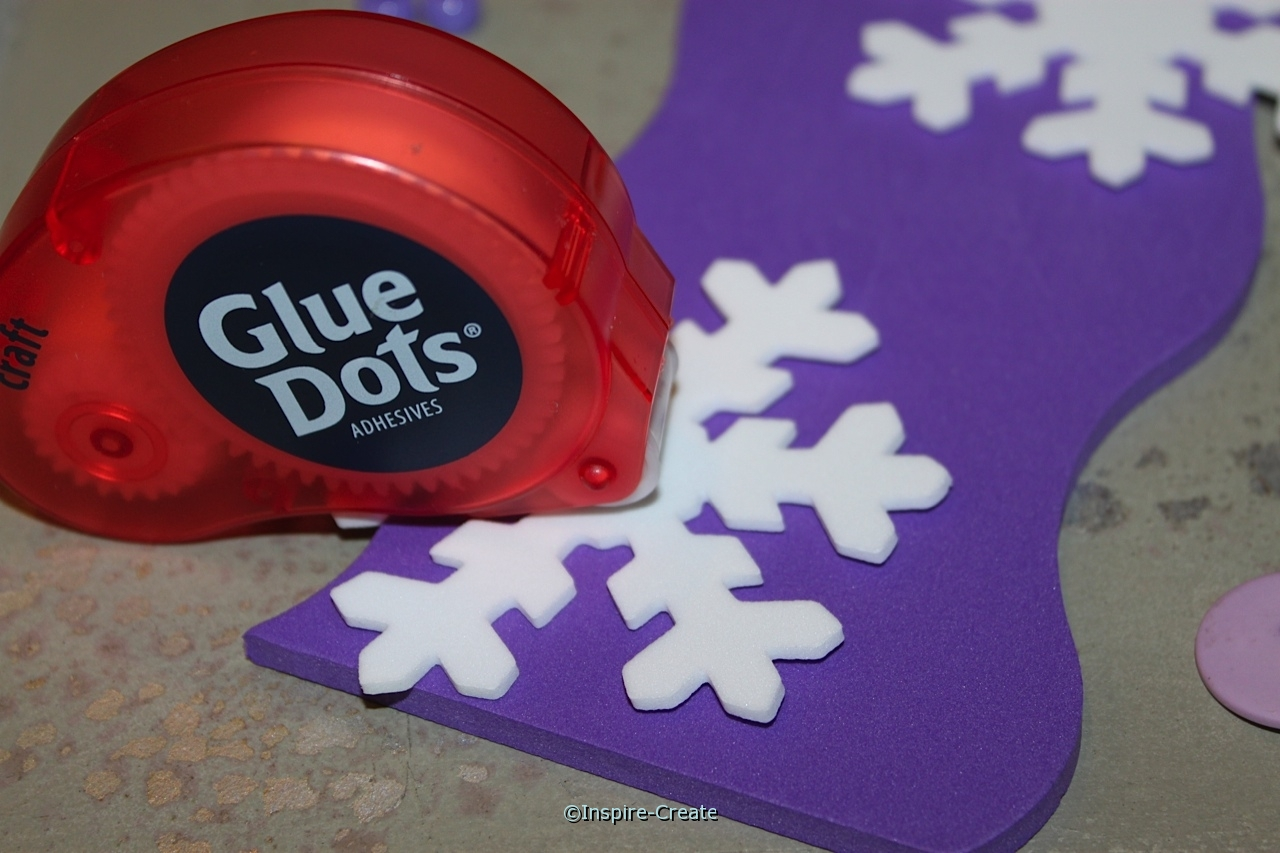 attach snowflakes with glue dots
