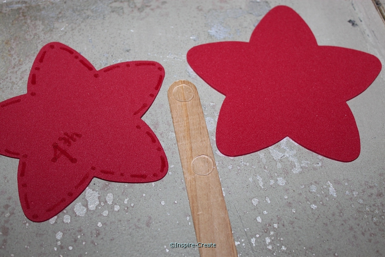 add craft foam stars to jumbo craft sticks with Glue Dots