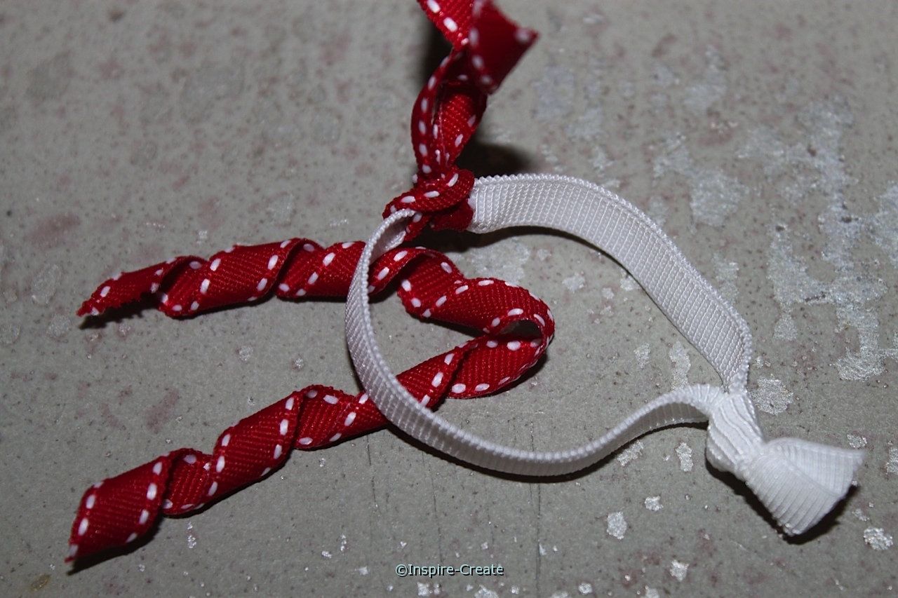 add curly ribbon pieces to stretchy hair tie