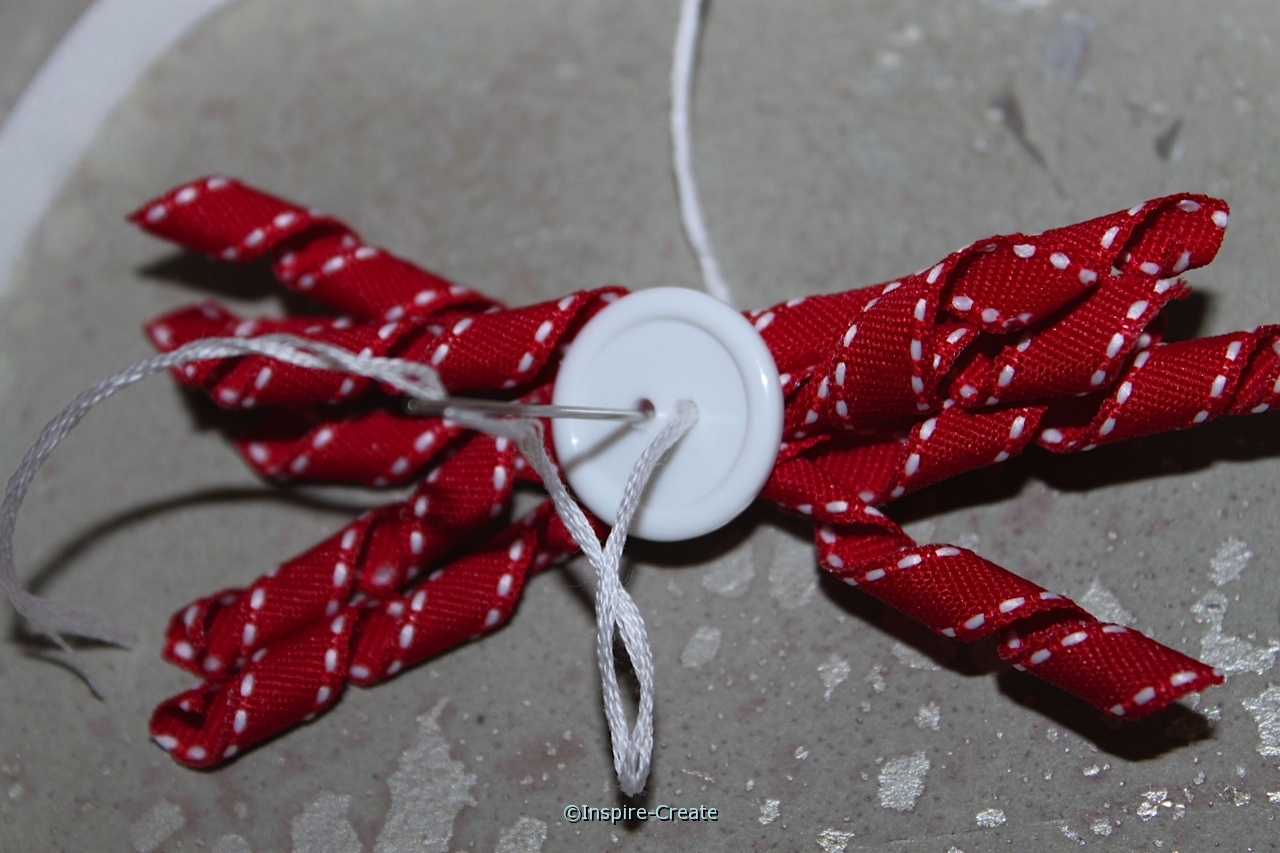 sew large button to curly ribbon for headband
