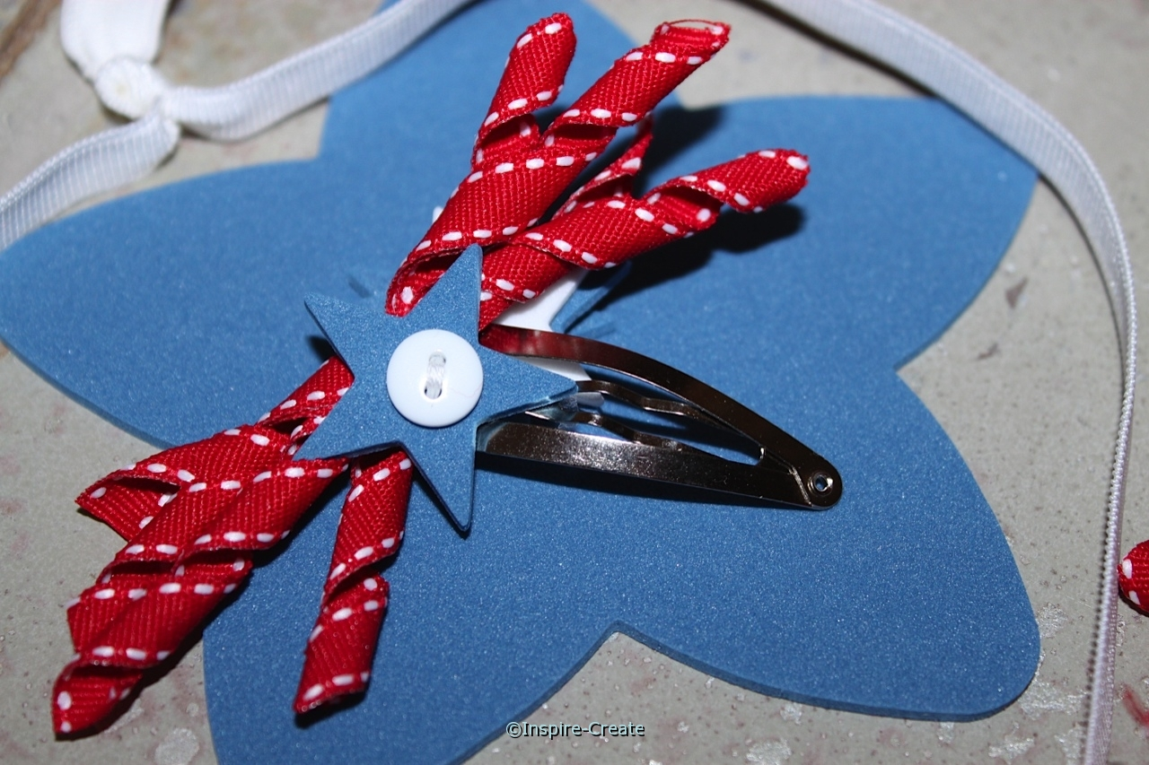 red, white, and blue star and ribbon hair clip