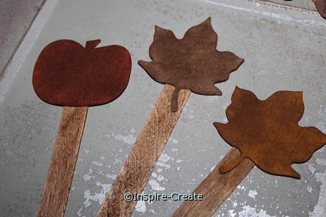 Add wood craft sticks to Coffee Foam Shapes.